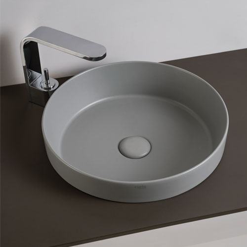 Semi-recessed round washbasin