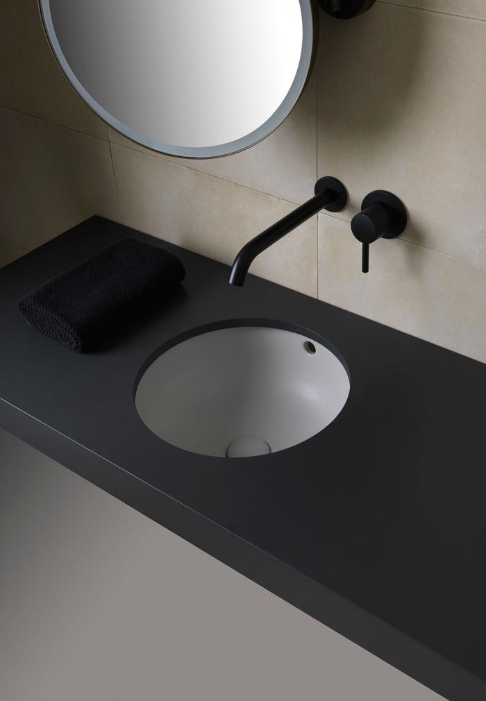 Enjoy undercounter round washbasin Talco finishes. Pluto mirror with light Nero matt finishes.