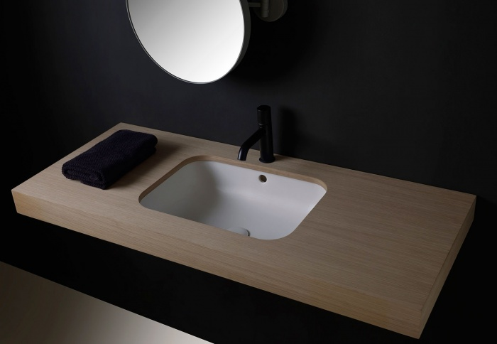 Enjoy undercounter rectangular washbasin Talco finishes. Pluto mirror Titanio finishes.