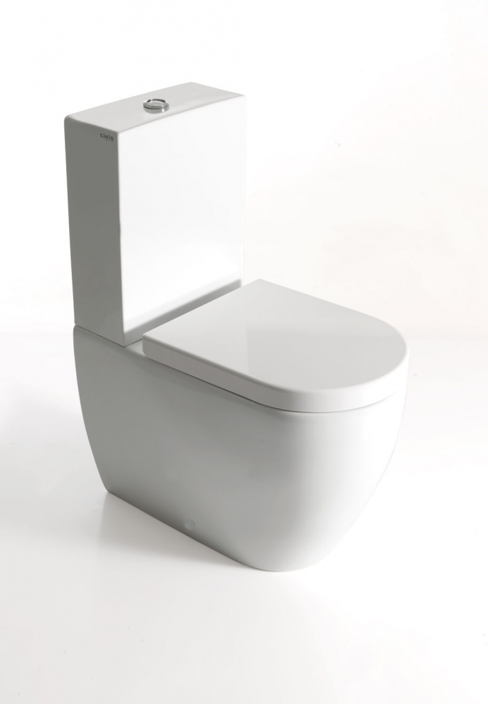 Mini monoblock wc with horizontal outlet convertible to floor outlet by technical curve Gloss white finishes.