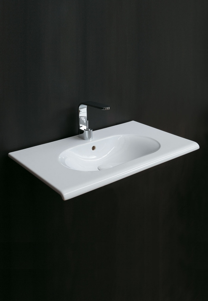 100 wall-hung washbasin. Glossy White finishes.