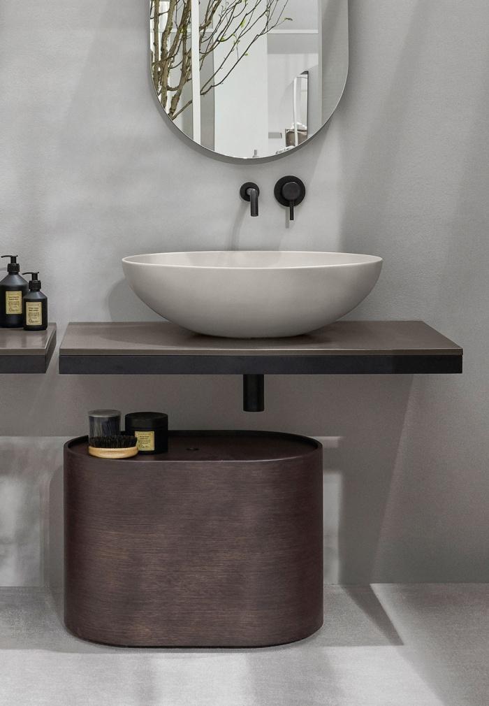Otto oval pouf in Rovere Grigio. Multiplo: steel framework Matt Black, Arenaria countertop. Eco Pomice washbasin